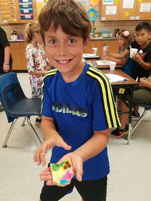 Student with Ohio Shaped Graham Cracker